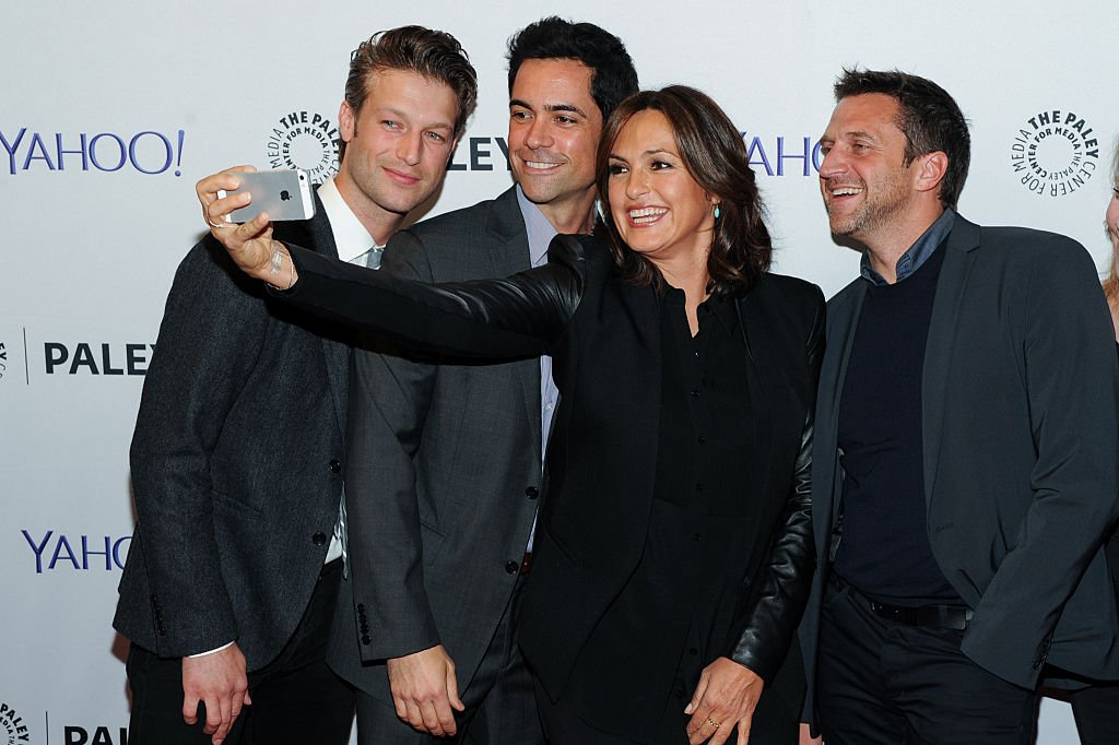 Image Source: Getty Images/Law and Order: SVU/NBC | Peter Scanavino, Danny Vino, Marishka Hargitay, and Raul Esparza taking a selfie in Yahoo's event