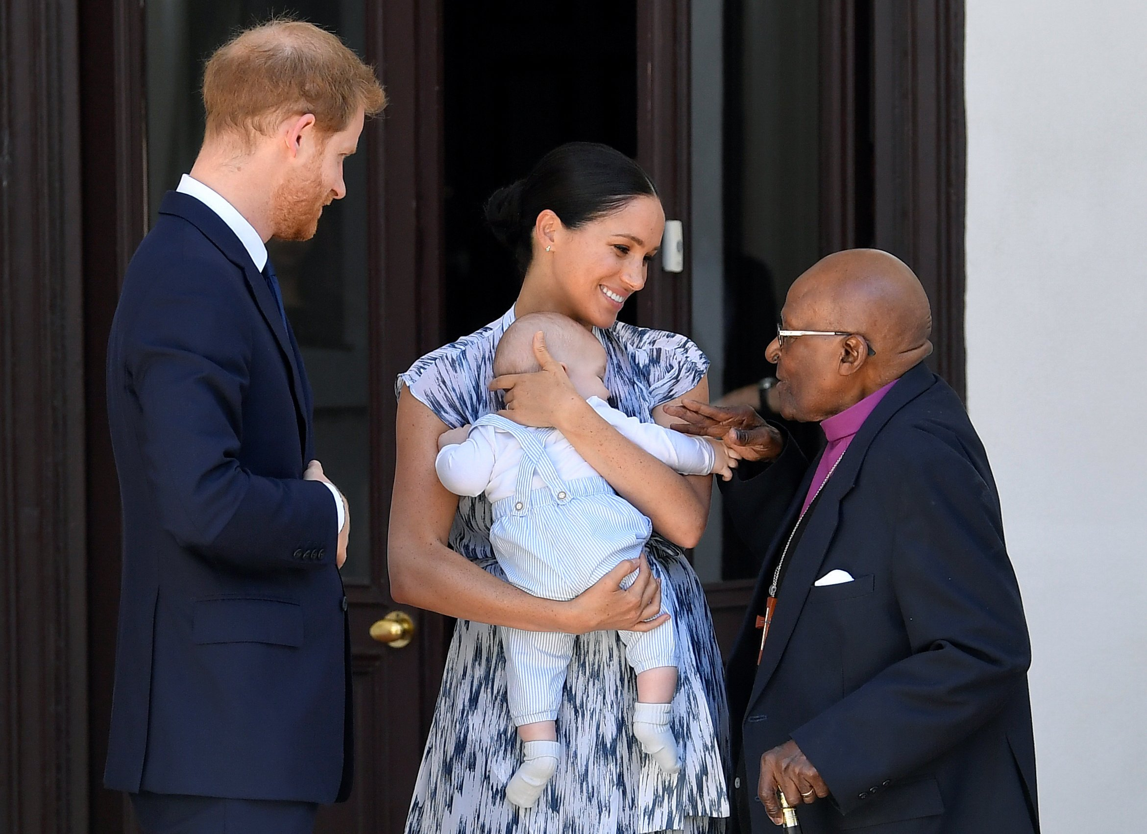 Image Credits: Getty Images / Toby Melville - Pool   Prince Harry, Duke of Sussex, Meghan, Duchess of Sussex and their baby son Archie Mountbatten-Windsor meet Archbishop Desmond Tutu at the Desmond & Leah Tutu Legacy Foundation during their royal tour of South Africa on September 25, 2019 in Cape Town, South Africa.