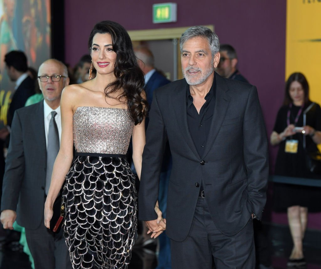 """Image Credit: Getty Images / Amal Clooney and George Clooney attend the """"Catch 22"""" UK premiere at the Vue Westfield on May 15, 2019 in London, United Kingdom."""