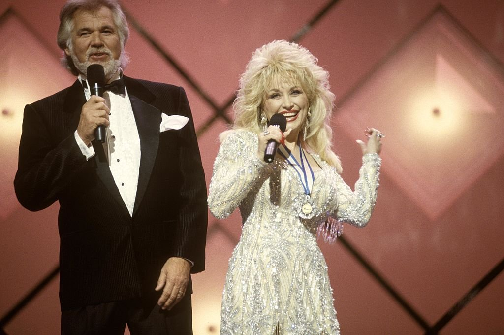 Image Credits: Getty Images / Beth Gwinn / Redferns | Photo of Dolly Parton and Kenny Rogers.
