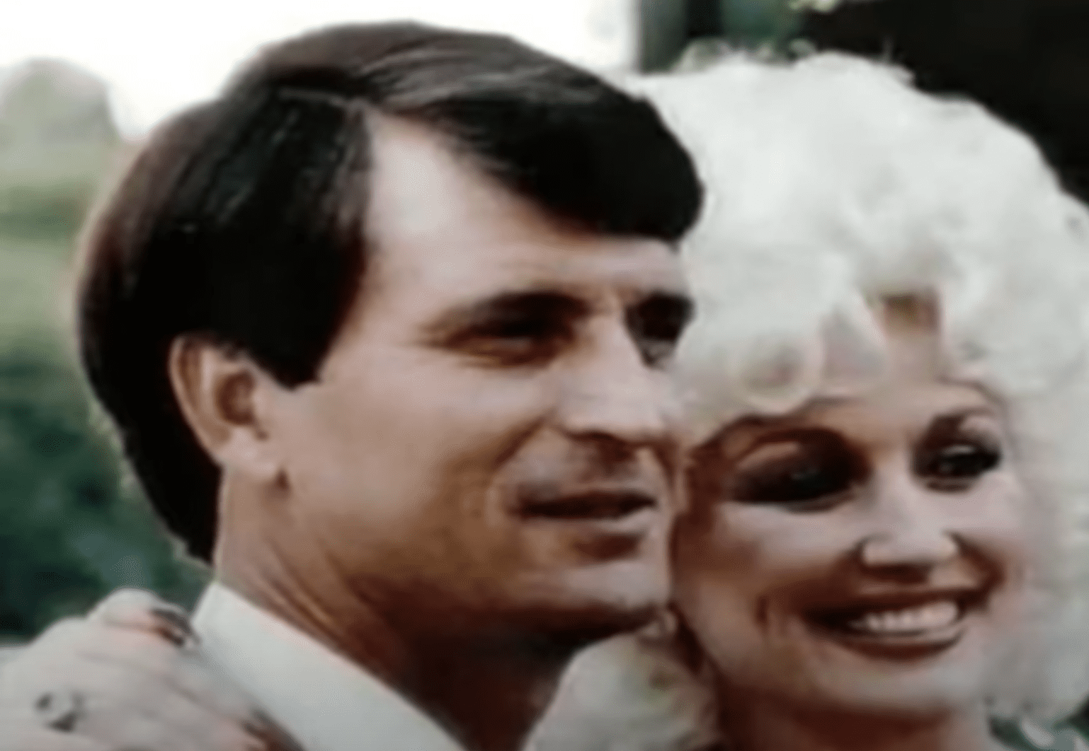 "Image Credits: YouTube /  dolly love | Dolly Parton and Carl Dean have a ""let live"" attitude"