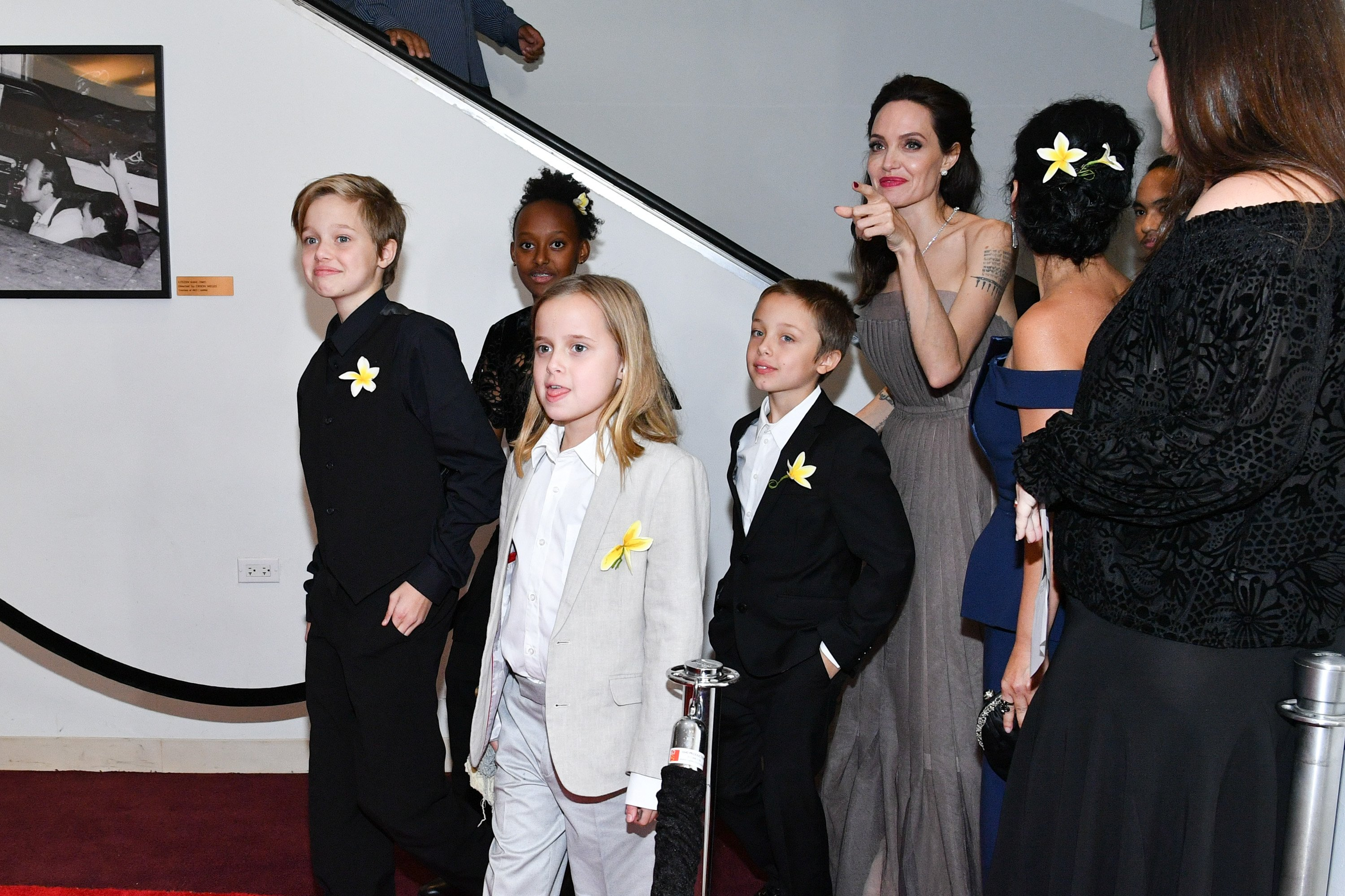 Image Source: Getty Images/ Jolie walking the red carpet with the kids