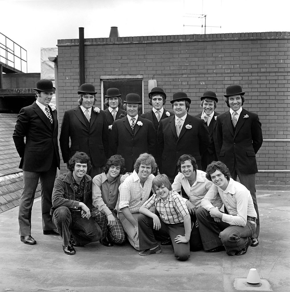 Image Source: Getty Images/Mirrorpix/The Osmond Brothers pop group pose with body guards dressed as city gents with bowler hats.