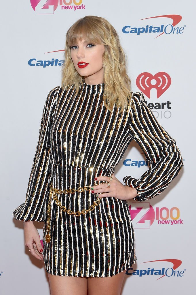 Image Credits: Getty Images / Jamie McCarthy | Taylor Swift poses backstage at iHeartRadio's Z100 Jingle Ball 2019 Presented By Capital One on December 13, 2019 in New York City.