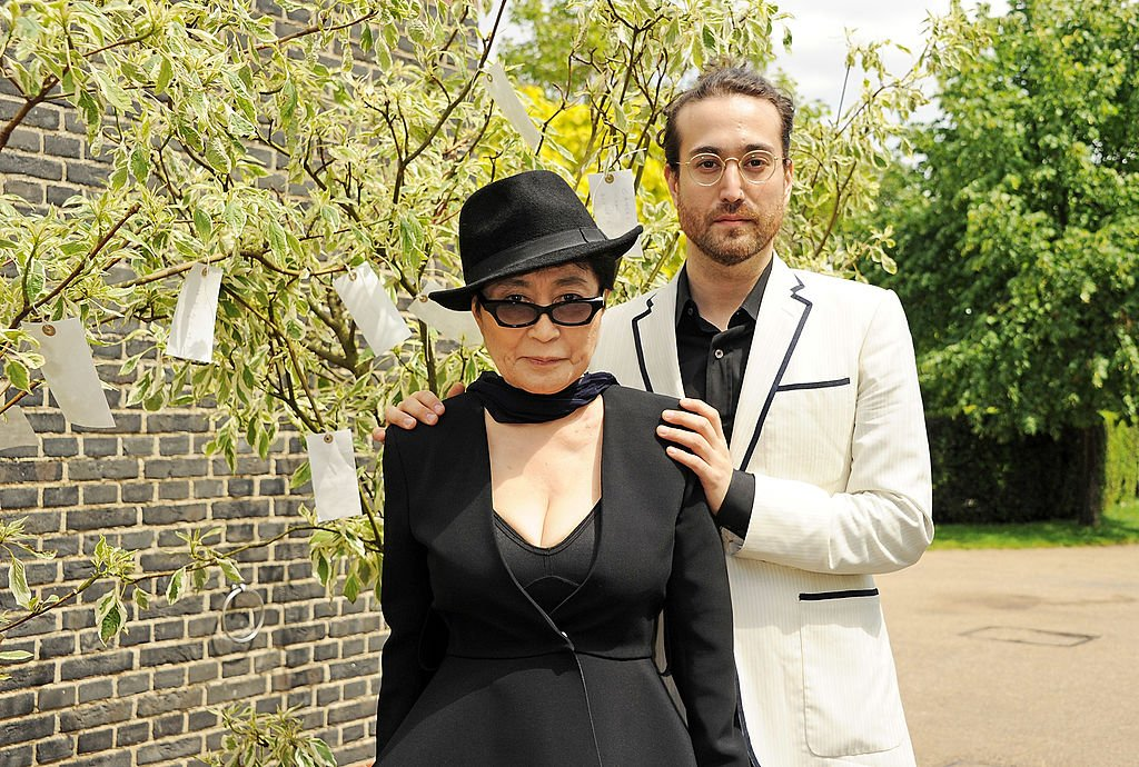 Image Credits: Getty Images / Dave M. Benett | Yoko Ono (L) and Sean Lennon pose during a photocall launching Yoko Ono's exhibition 'To The Light' at The Serpentine Gallery on June 18, 2012 in London, England.