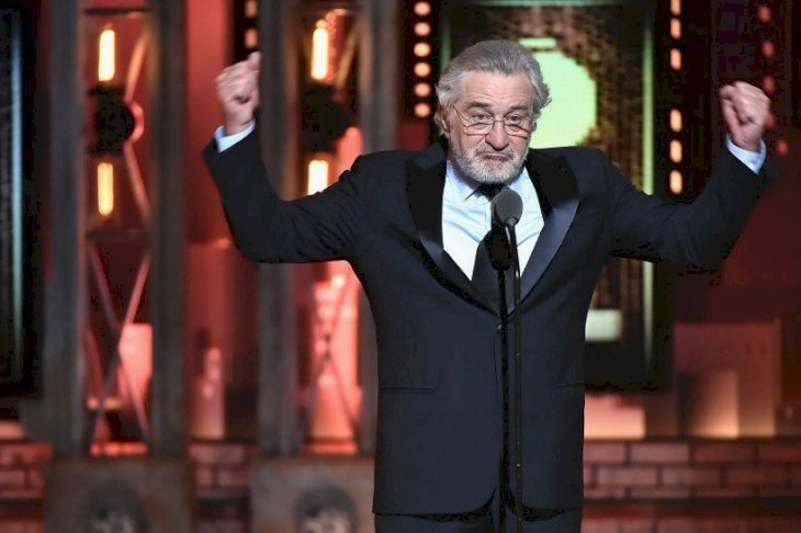 Image Credits: Getty Images / Theo Wargo | Robert De Niro speaks onstage during the 72nd Annual Tony Awards at Radio City Music Hall on June 10, 2018 in New York City.
