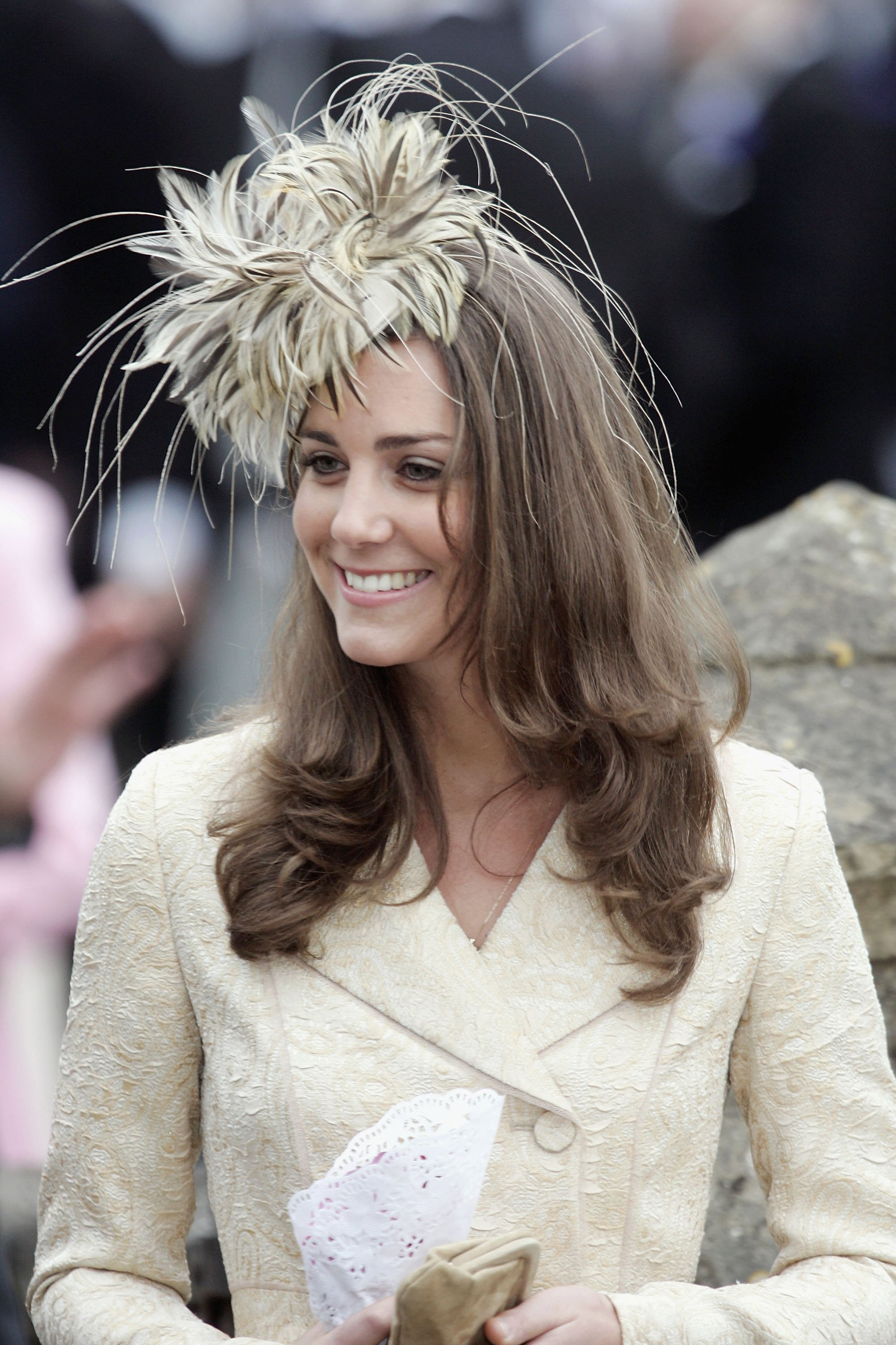 Image Source: Getty Images/Kate Middleton wearing a cream embroidered blazer and a matching hat