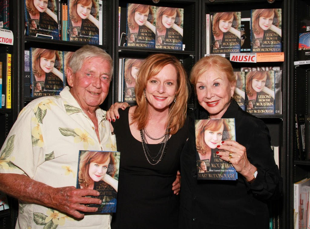 Image Credits: Getty Images / Brian Putnam | (L-R) Actors Ralph Waite, Mary McDonough and Michael Learned attend the signing of Mary McDonough's book 'Lessons From the Mountain: What I Learned From Erin Walton' at Book Soup on April 16, 2011 in West Hollywood, California.