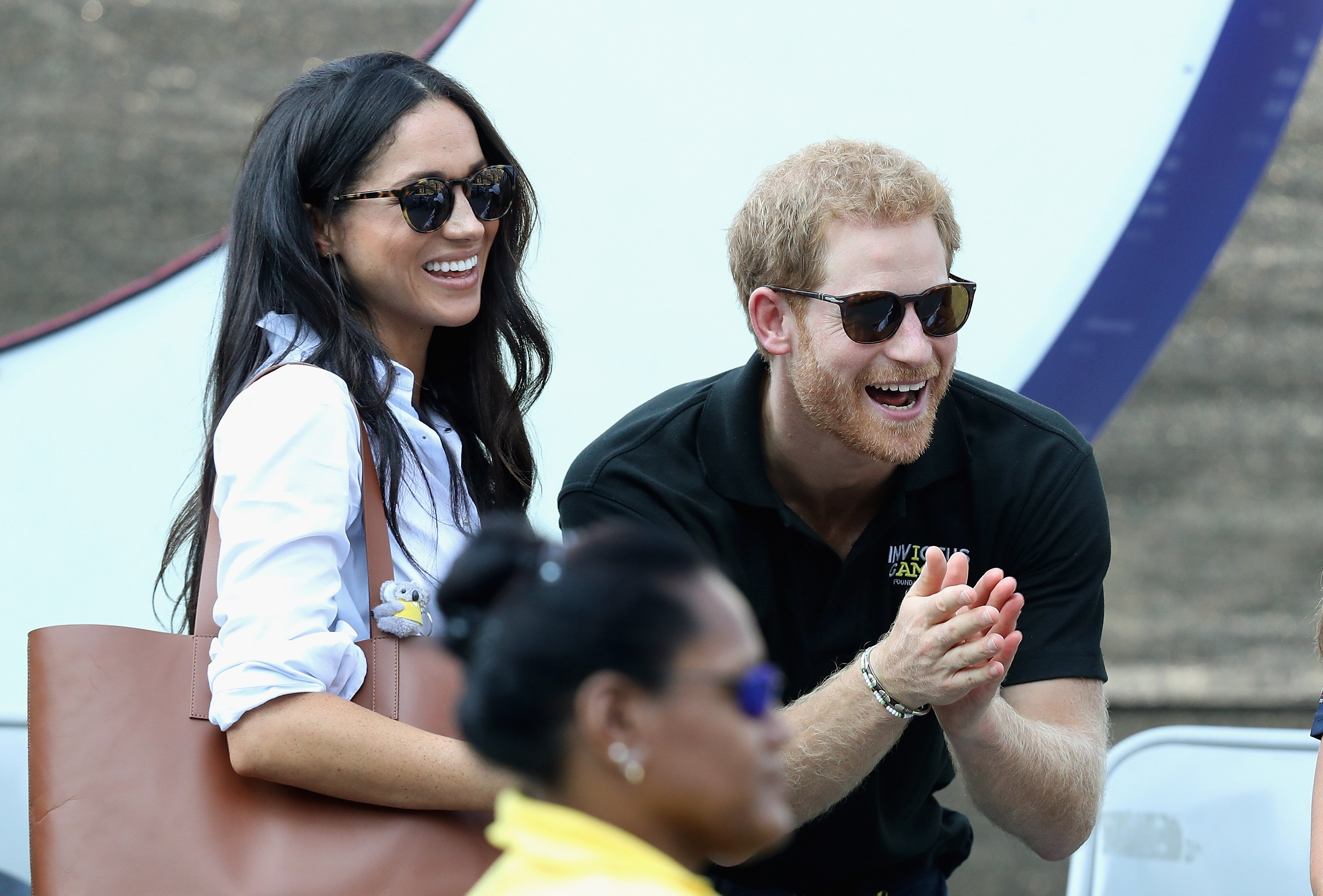 Image Credits: Getty Images / Chris Jackson | Prince Harry (R) and Meghan Markle (L) attend a Wheelchair Tennis match during the Invictus Games 2017 at Nathan Philips Square on September 25, 2017 in Toronto, Canada.