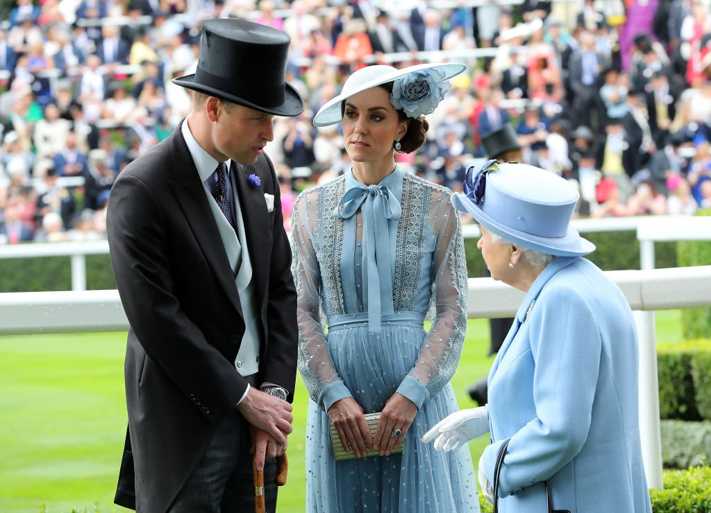 Image Credit: Getty Images / Prince William, Duke of Cambridge and Catherine, Duchess of Cambridge speak to Queen Elizabeth II at Ascot Racecourse on June 18, 2019 in Ascot.