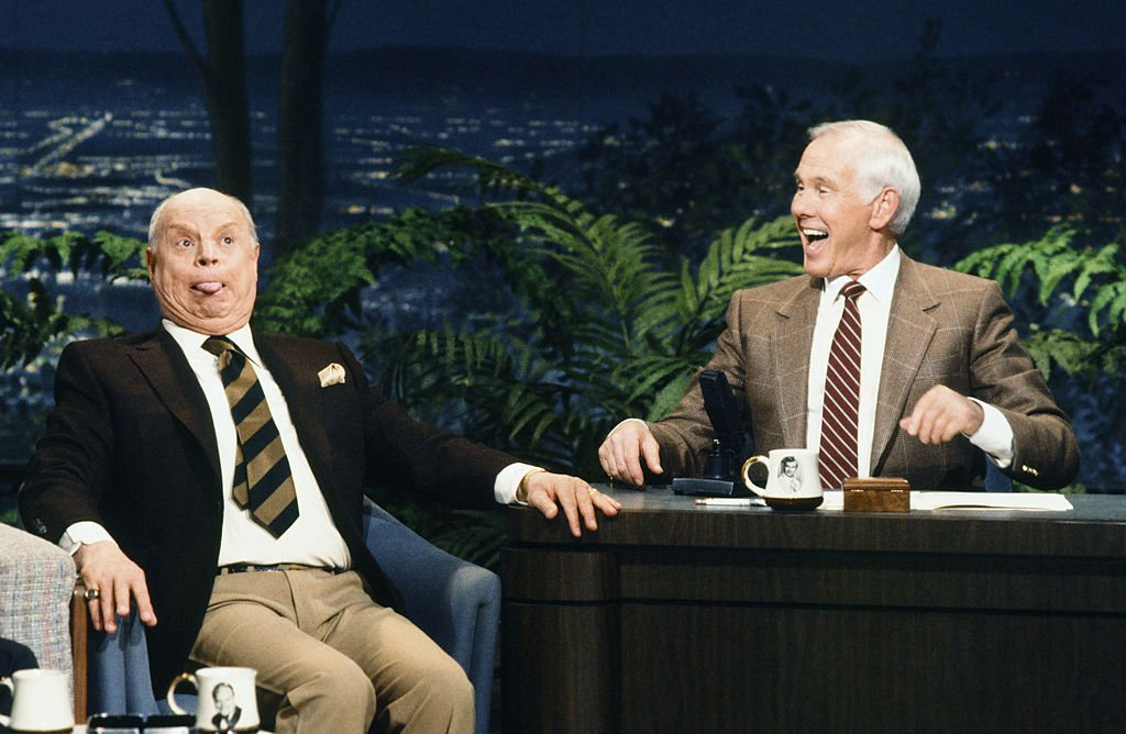Image Credits: Getty Images / Chris Haston / NBCU Photo Bank / NBCUniversal | Comedian/actor Don Rickles, host Johnny Carson on February 7, 1990.