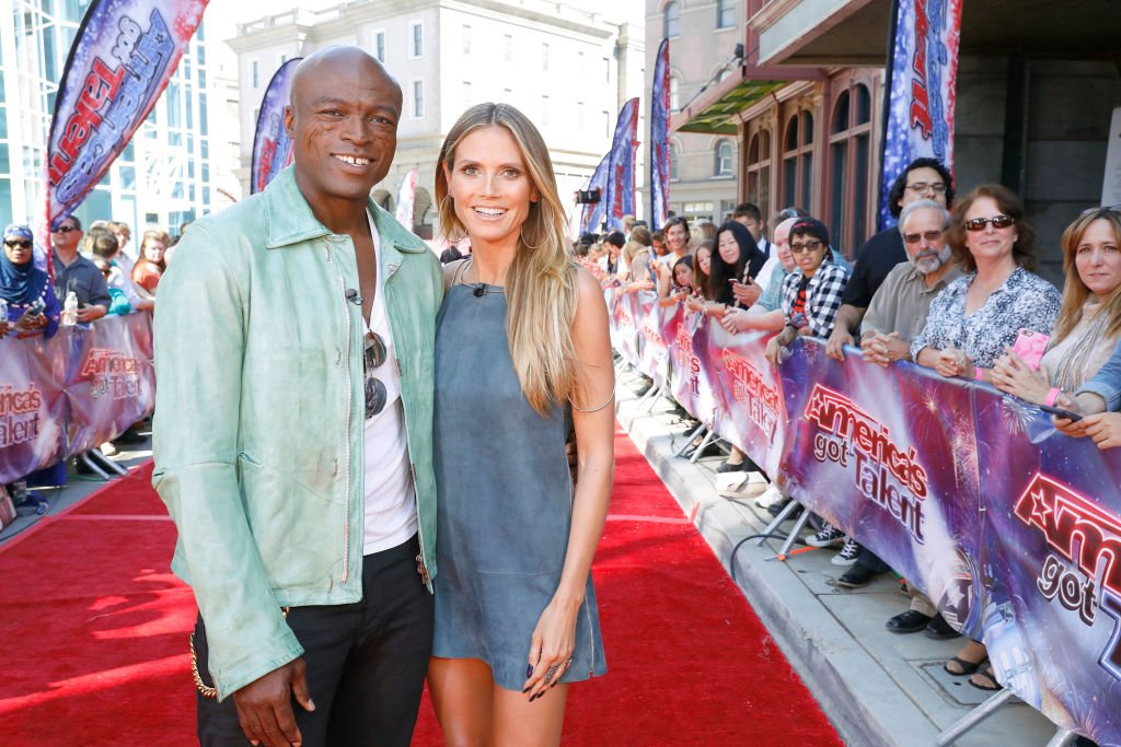 "Image Source: Getty Images/NBC/""Judge Cuts"" Episode 1211 -- Pictured: (l-r) Seal, Heidi Klum"