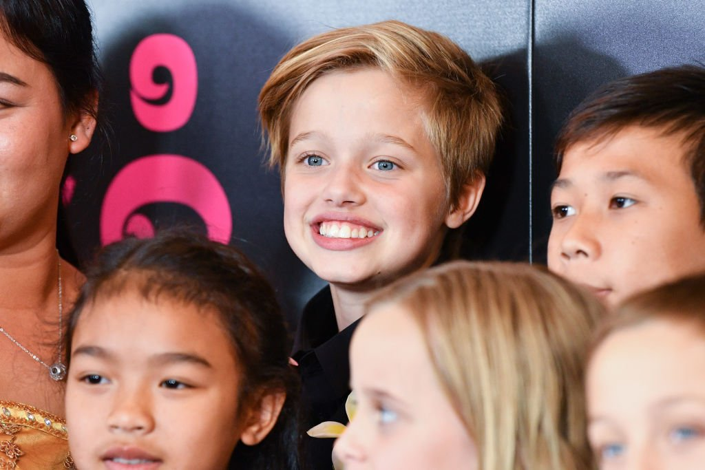 Image Source: Getty Images/The Jolie-Pitt kids smiling for the camera
