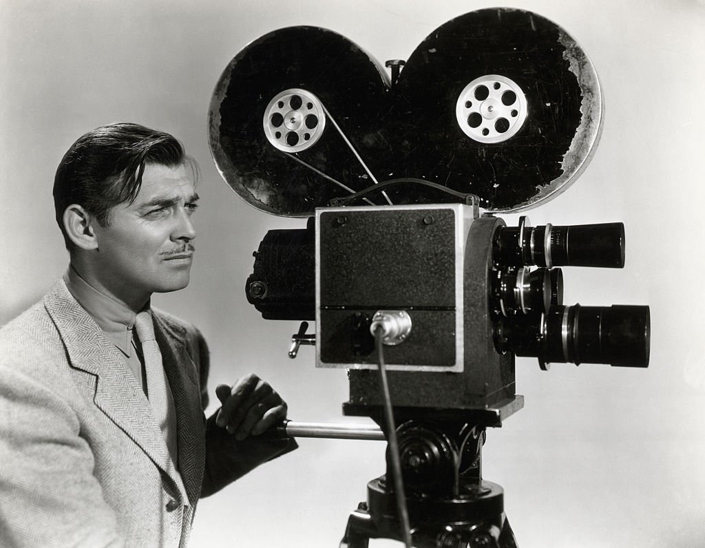 Image Credit: Getty Images / Clark Gable in a publicity photograph for his film Too Hot to Handle, 1938 in which he plays a newsreel reporter.