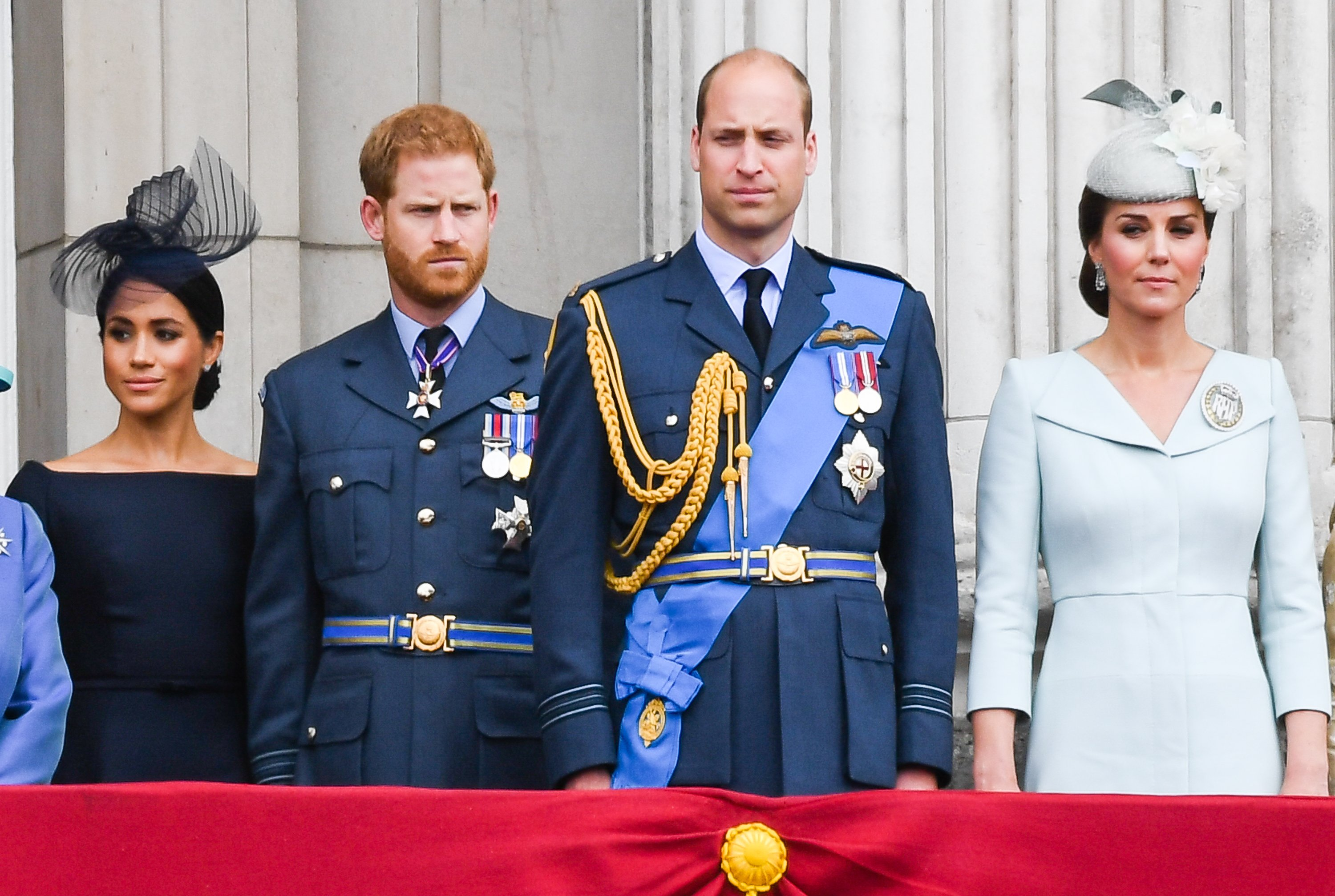 Image Credits: Getty Images / Anwar Hussein / WireImage   Meghan, Duchess of Sussex, Prince Harry, Duke of Sussex, Prince William, Duke of Cambridge and Catherine, Duchess of Cambridge stand on the balcony of Buckingham Palace to view a flypast to mark the centenary of the Royal Air Force (RAF) on July 10, 2018 in London, England.