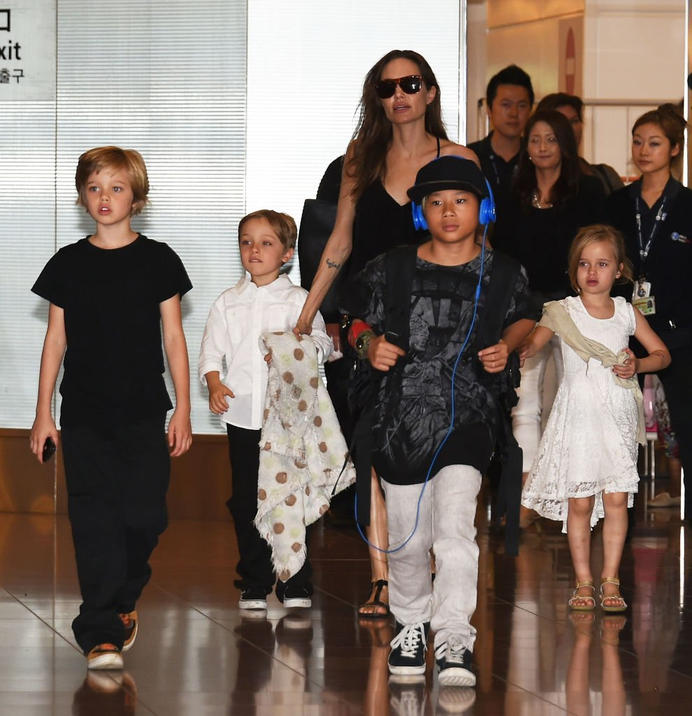 Image Source: Getty Images/Jun Sato/Shiloh Jolie-Pitt, Knox Jolie-Pitt, Angelina Jolie, Pax Jolie-Pitt and Vivienne Jolie-Pitt are seen upon arrival at Haneda Airport on June 21, 2014 in Tokyo, Japan