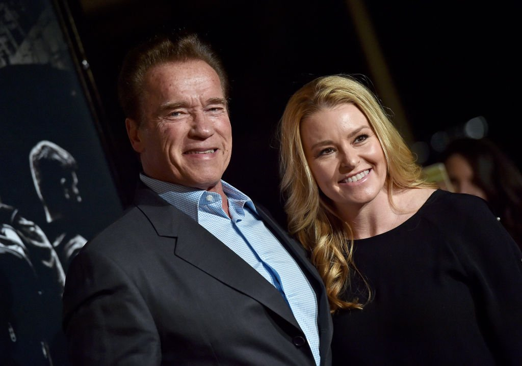 Image Credits: Getty Images / Axelle / Bauer-Griffin / FilmMagic | Actor Arnold Schwarzenegger and Heather Milligan attend the premiere of 'The 15:17 To Paris' at Warner Bros. Studios on February 5, 2018 in Burbank, California.