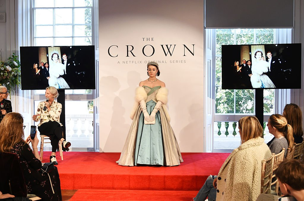"""Image Credits: Getty Images / David M. Benett / Dave Benett   Caryn Franklin (L) and Michele Clapton speak as a model poses at a presentation featuring costumes from new Netflix Original series """"The Crown"""" with designer Michele Clapton at the ICA on October 17, 2016 in London, England."""