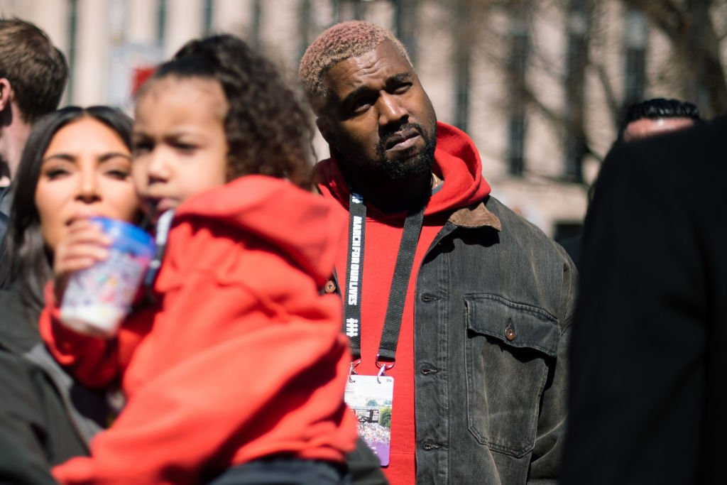 Image Credit: Getty Images / Kanye West attends the March For Our Lives in Washington D.C. with wife Kim Kardashian West and daughter North West.