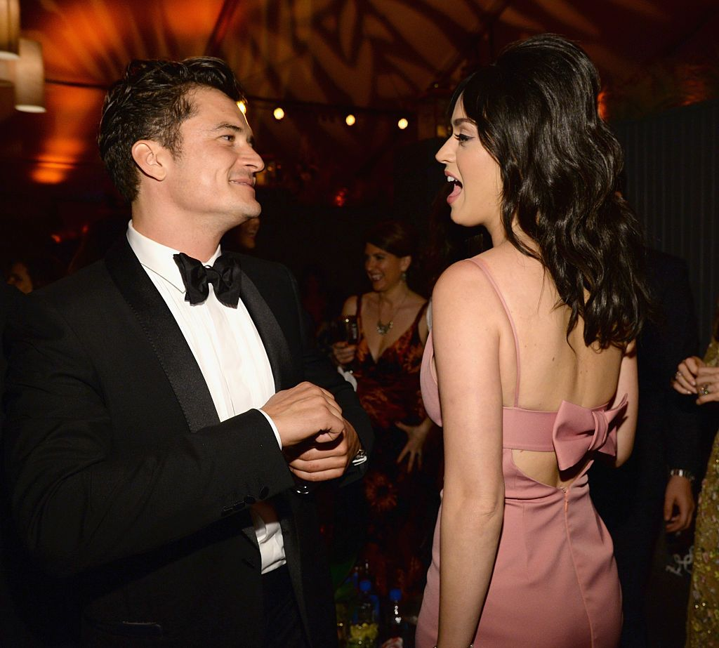 Katy Perry and Orlando Bloom dancing together / Getty Images