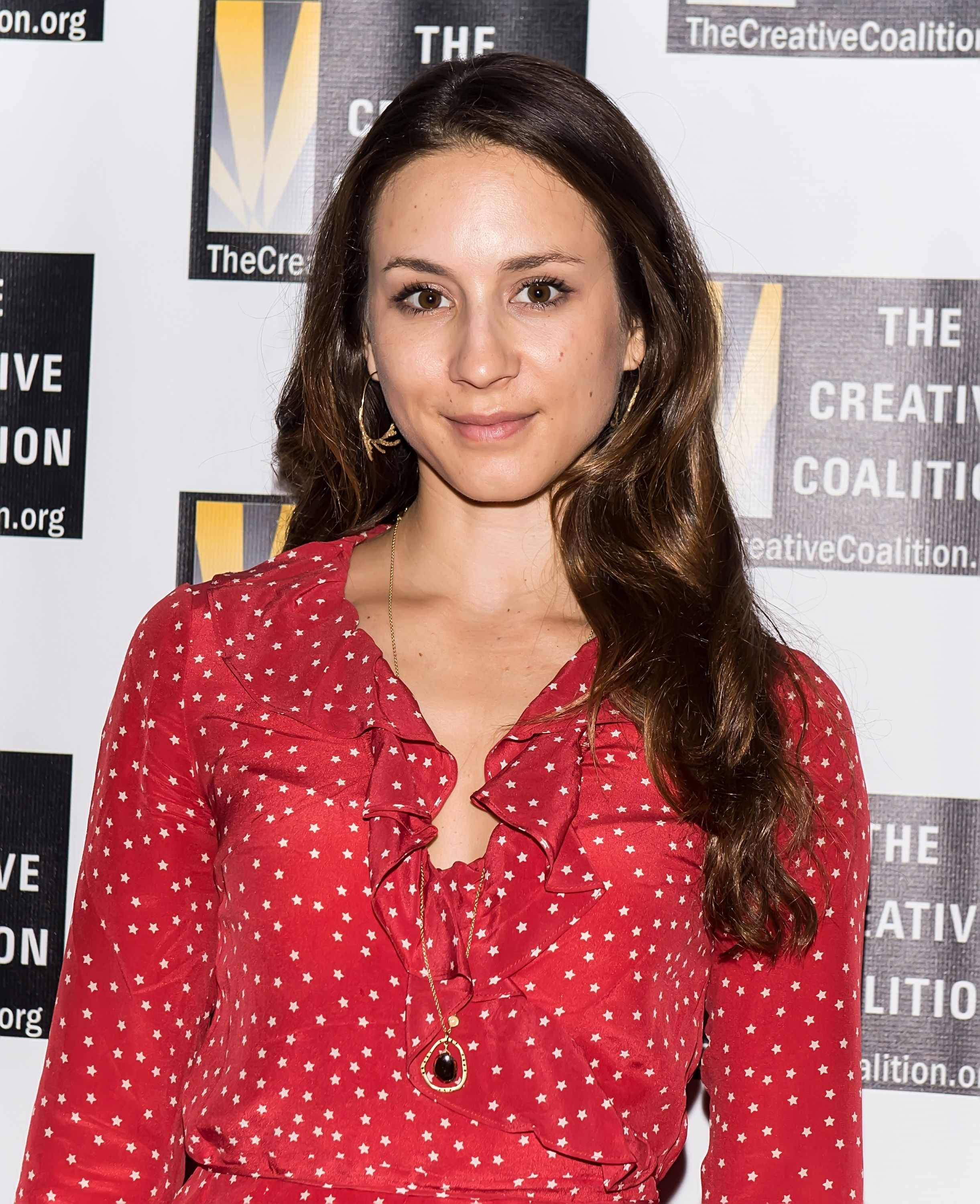 Troian Bellisario who portrayed Spencer Hastings on PLL / Getty Images
