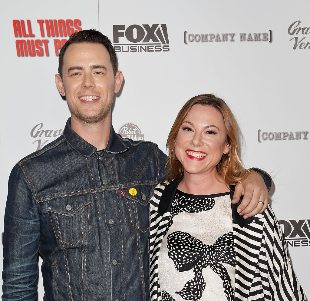 Image Credits: Getty Images / Tibrina Hobson / FilmMagic | Colin Hanks and Samantha Bryant attend the premiere of 'All Things Must Pass' at Harmony Gold Theatre on October 15, 2015 in Los Angeles, California.