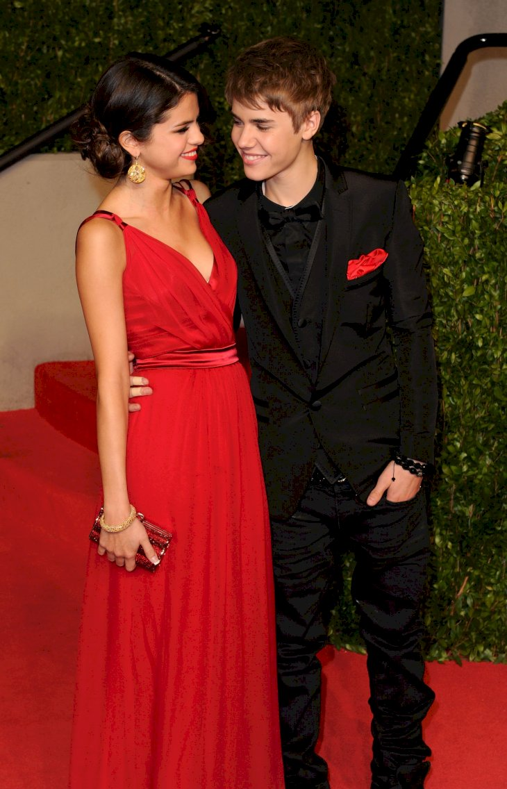Image Credit: Getty Images/Craig Barritt |  Selena Gomez and singerJustin Bieber arrive at the Vanity Fair Oscar party