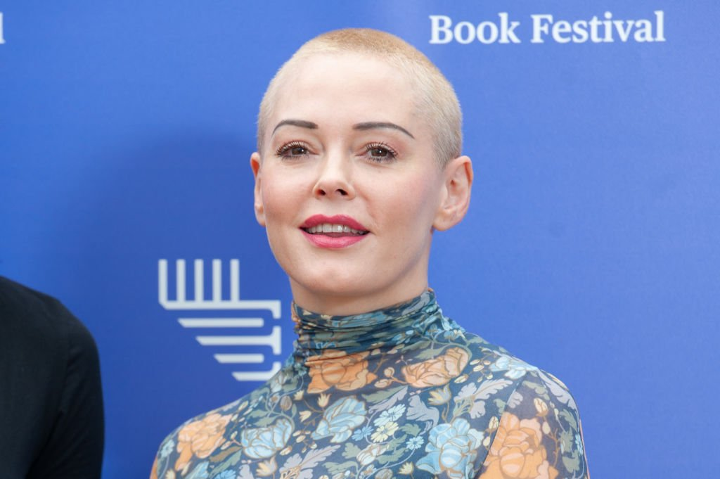 Image Credit: Getty Images / American activist, former actress, author, model and singer Rose McGowan attends a photocall during the annual Edinburgh International Book Festival at Charlotte Square Gardens on August 13, 2018.