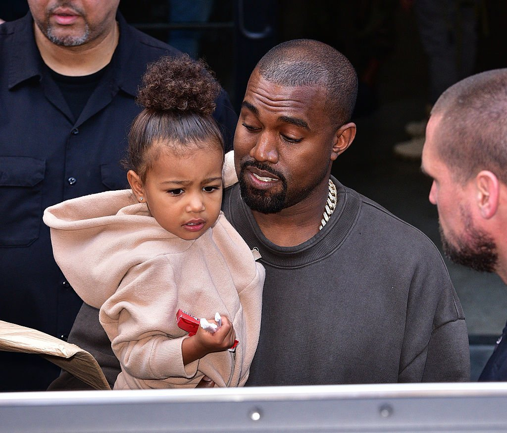 Image Credit: Getty Images / North West and Kanye West leave Kanye West Yeezy Season 2 New York Fashion Week show at Skylight Modern on September 16, 2015 in New York City.