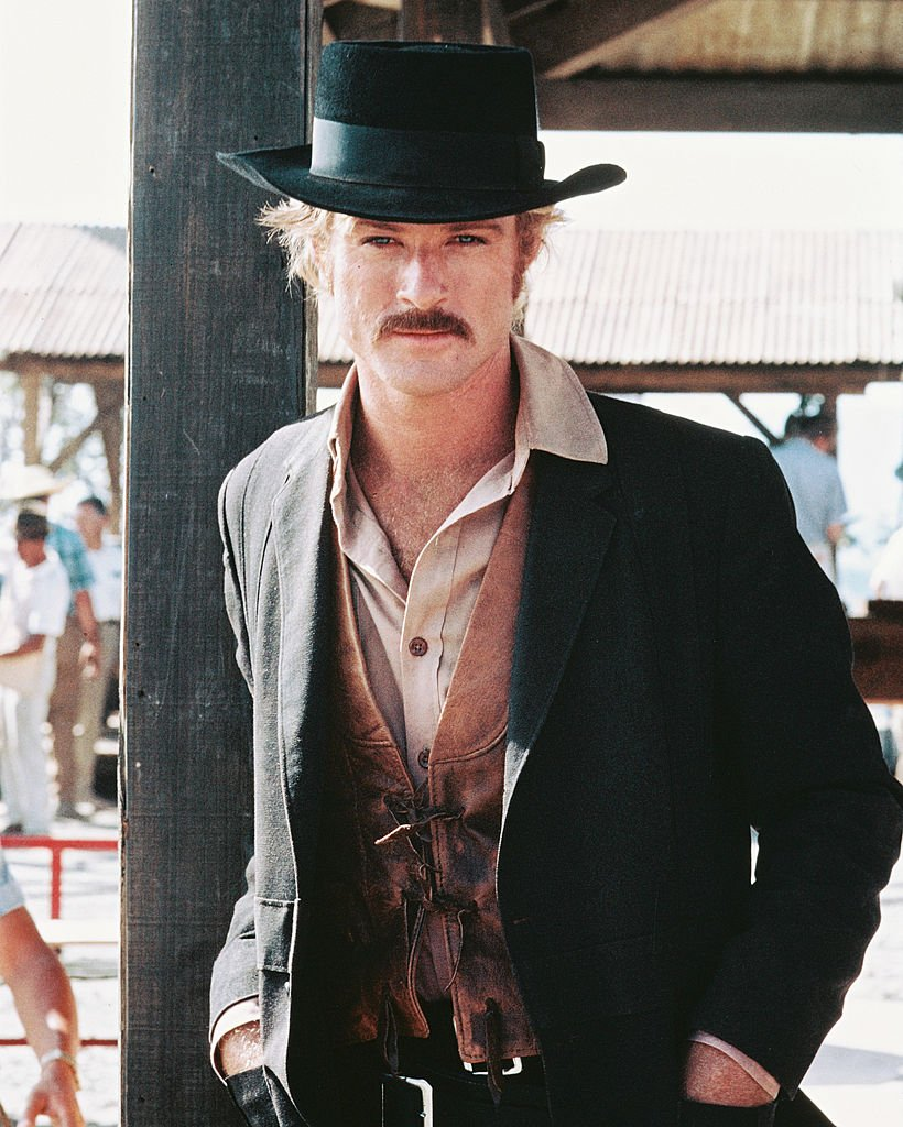 Image Credits: Getty Images / Silver Screen Collection | Robert Redford, US actor, in a Western costume, with a black cowboy hat and tan leather waistcoat, in a publicity portrait issued for the film, 'Butch Cassidy and the Sundance Kid', 1969. The Western, directed by George Roy Hill (1921-2002), starred Redford as 'The Sundance Kid'.