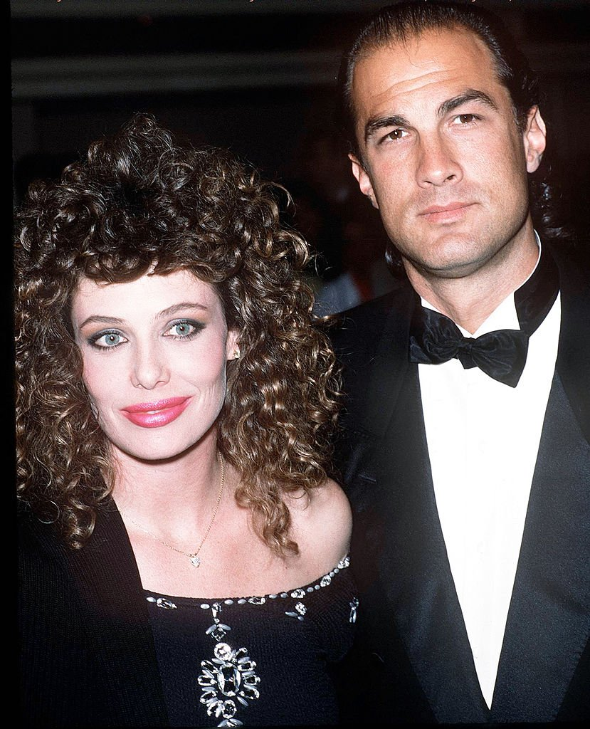 Image Credits: Getty Images / Kypros | Model Kelly LeBrock and her husband, actor Steven Seagal attend the 16th Annual American Film Institute Lifetime Achievement Awards Honoring Jack Lemmon on March 10, 1988 at the Beverly Hilton Hotel in Beverly Hills, California.