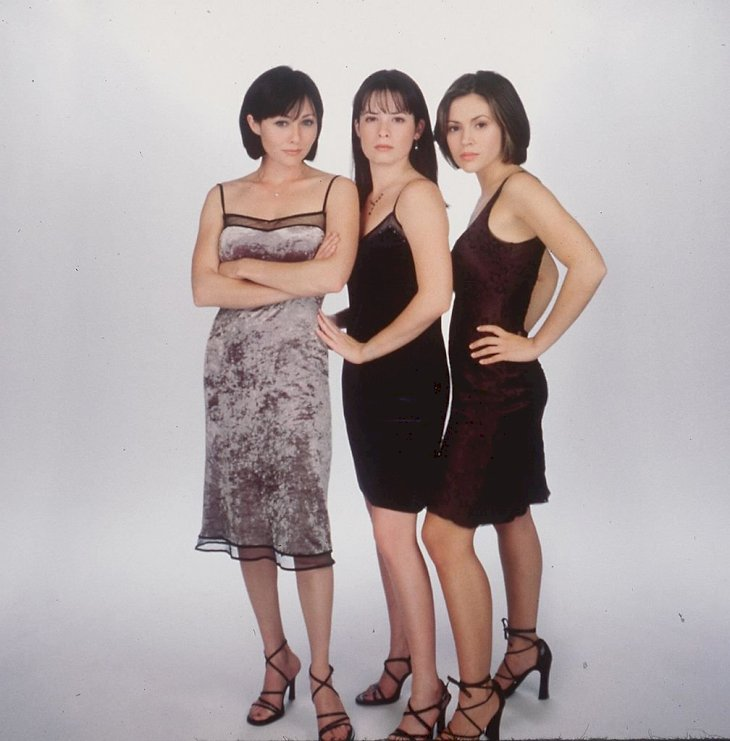 Image Credits: Getty Images / Hulton Archive | Holly Marie Combs as Piper Halliwell, Shannen Doherty as Prue Halliwell and Alyssa Milano as Phoebe Halliwell.