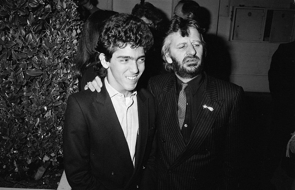 Image Credits: Getty Images / The LIFE Picture Collection | Ringo Starr and stepson Gianni Gregorini. They are at Chasen's restaurant in Beverly Hills.