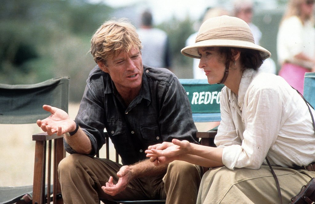 Image Credits: Getty Images / Hemdale | Robert Redford and Meryl Streep during production for the film 'Out Of Africa', 1985.