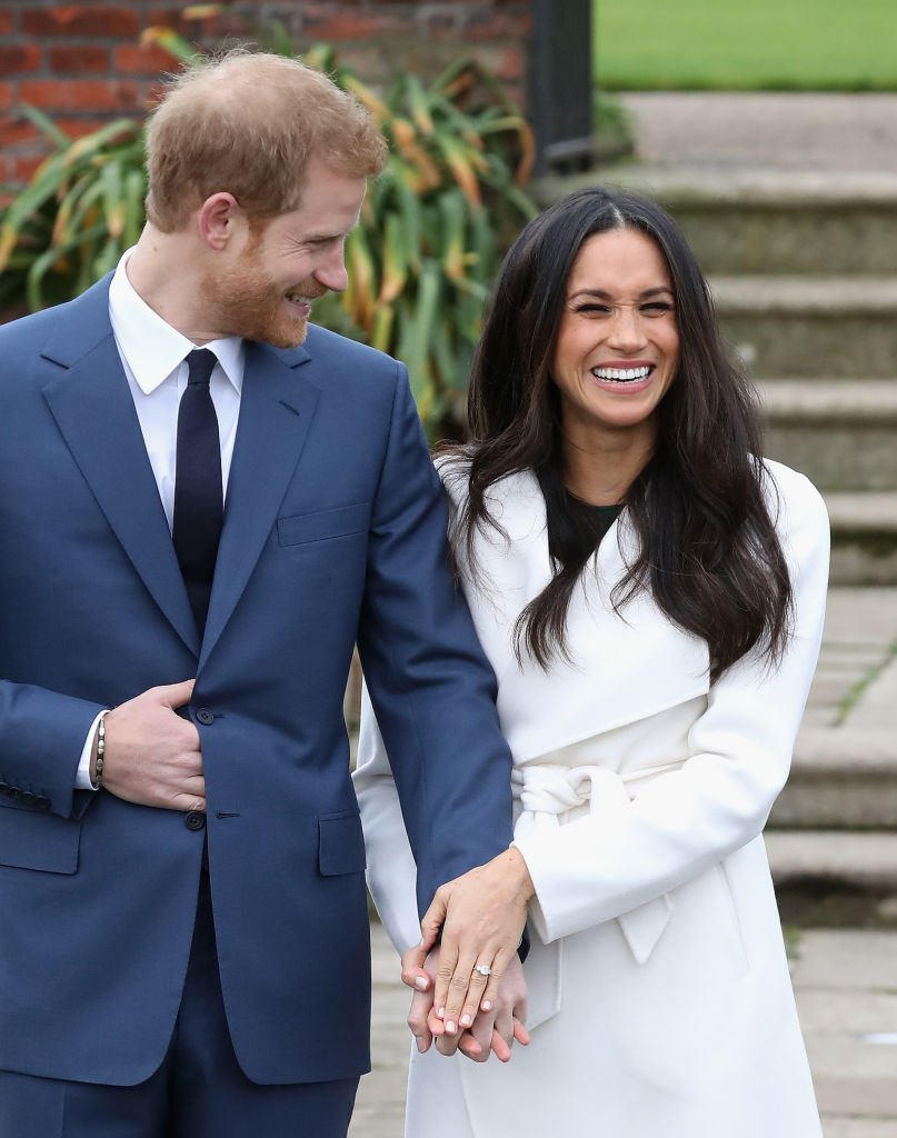 Image Credits: Getty Images / Chris Jackson   Prince Harry and Meghan Markle during an official photocall to announce the engagement of Prince Harry and actress Meghan Markle at The Sunken Gardens at Kensington Palace on November 27, 2017 in London, England. Prince Harry and Meghan Markle have been a couple officially since November 2016 and are due to marry in Spring 2018.