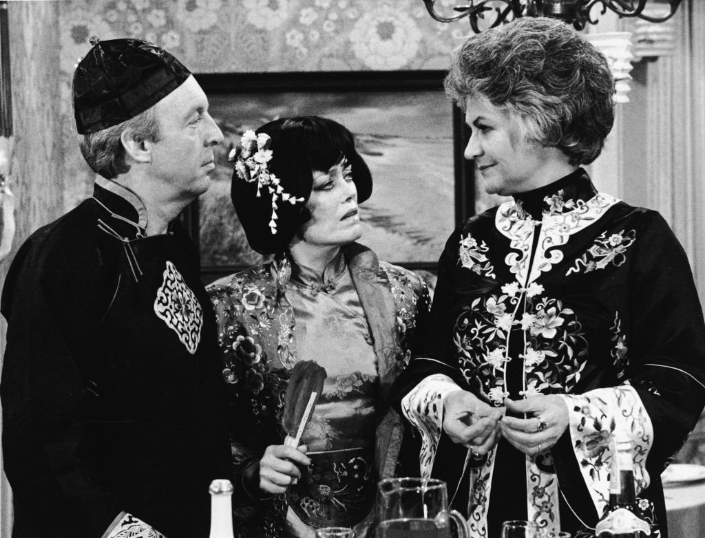 Image Credits: Getty Images / CBS Photo Archive | L-R: Actors Conrad Bain, Rue McLanahan and Beatrice Arthur wear Asian costumes in a still from the TV series, 'Maude,' 1978.