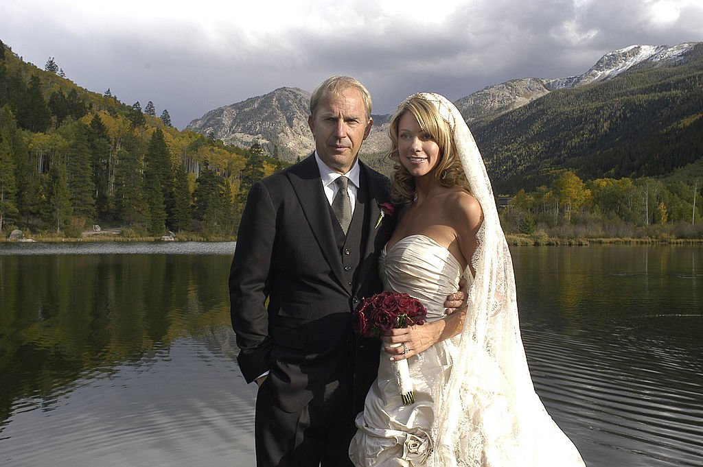 Image Credit: Getty Images / Kevin Costner married his girlfriend of 5 years, Christine Baumgartner at their Aspen, Colorado ranch on September 25, 2004.