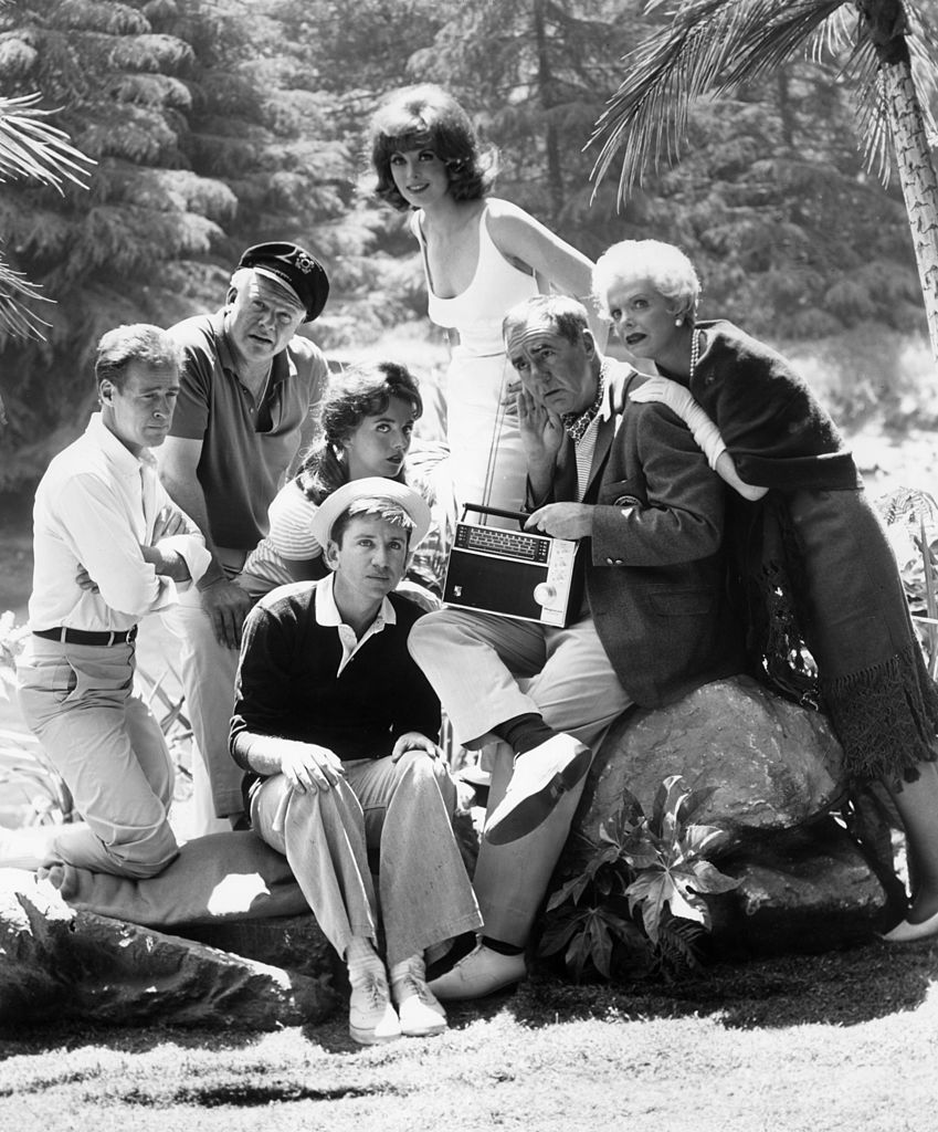 Image Source: Getty Images/Hulton Archive/The cast of the television comedy series, 'Gilligan's Island,' which ran from 1964-1967, listens to a short wave radio outdoors in a promotional portrait