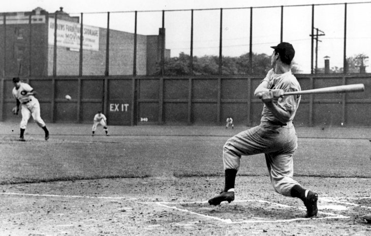 Image Credit: Getty Images / Joe DiMaggio playing baseball with his teammates.