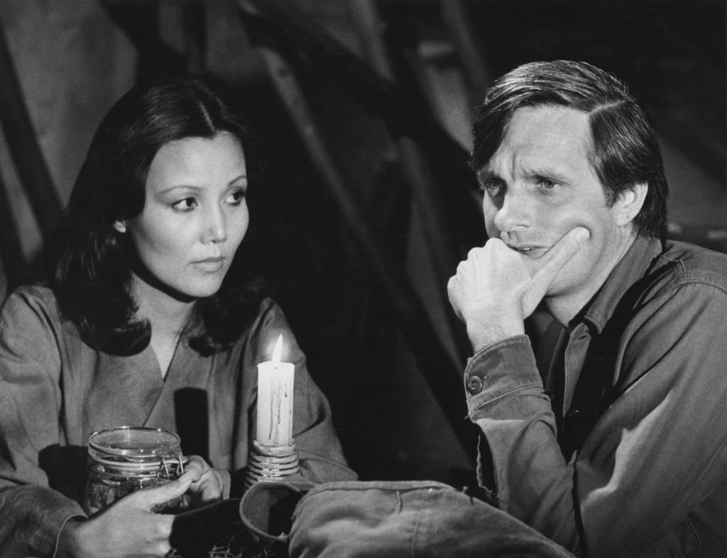 Image Credits: Getty Images / CBS Photo Archive | Kieu Chinh and Alan Alda star in 'In Love and War', an episode of  'M*A*S*H',