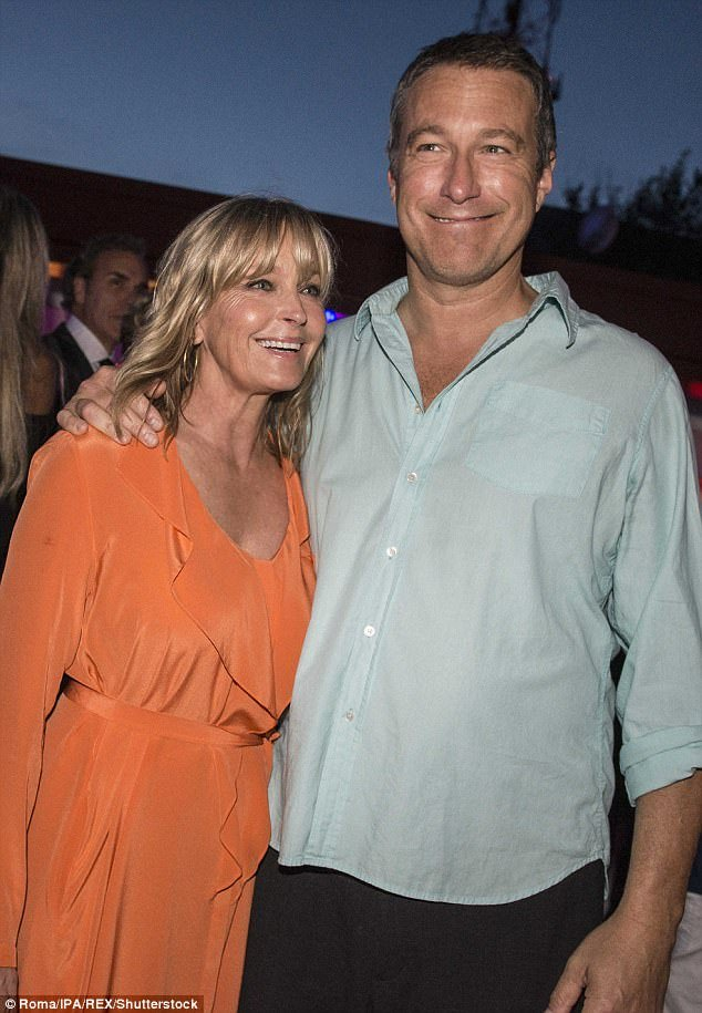 Image Credits: Shutterstock / / The model and Hollywood actor Bo Derek and John Corbett are photographed by the press.