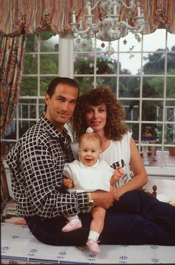 Image Credits: Getty Images / Paul Harris | Steven Seagal and his wife, actress/supermodel Kelly LeBrock at home when they where married and had their first child.
