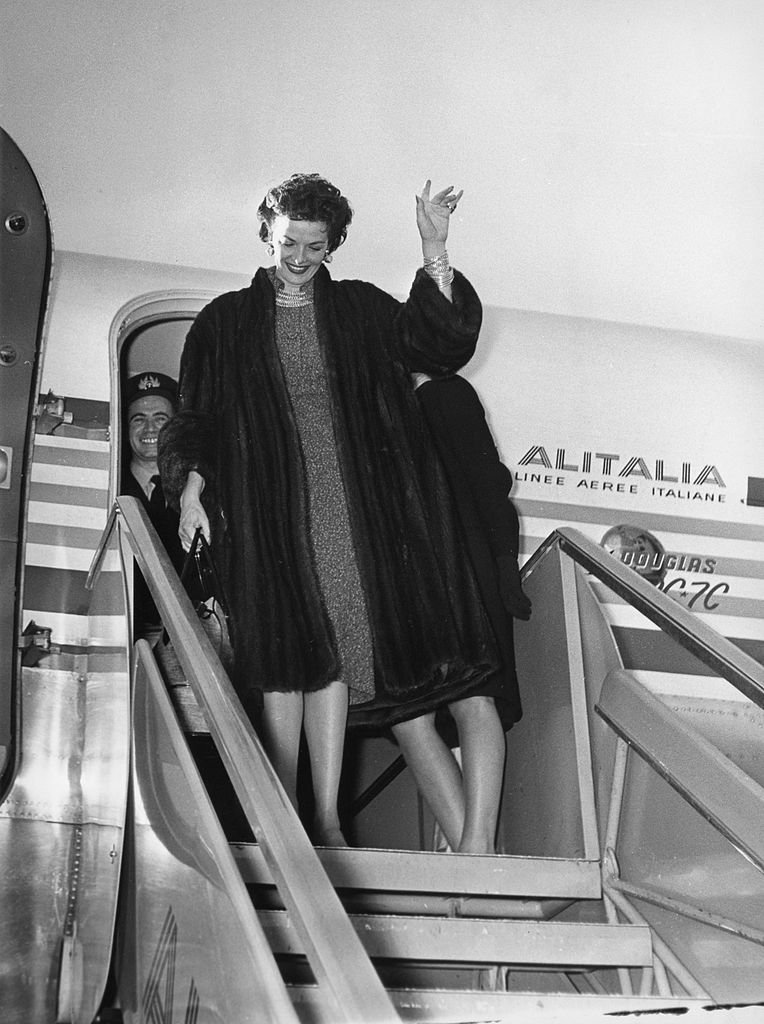 Image Source: Getty Images/Alinari Archives/The American actress Jane Russell greets from the ladder of a plane an airplane of Alitalia