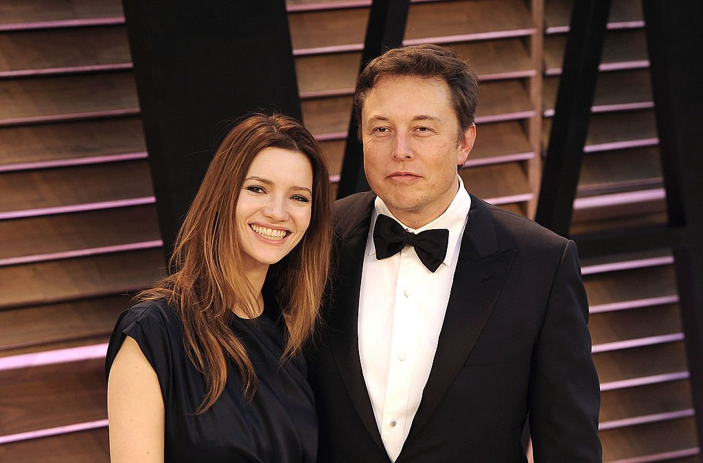 Image Credit: Getty Images / Actress Talulah Riley (L) and CEO of Tesla Motors Elon Musk arrive to the 2014 Vanity Fair Oscar Party on March 2, 2014 in West Hollywood, California.