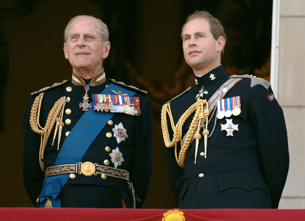 Image Credit: Getty Images / Prince Edward, Earl of Wessex and Prince Philp, Duke of Edinburgh watch the flypast on National Commemoration Day, July 10, 2005, in London.