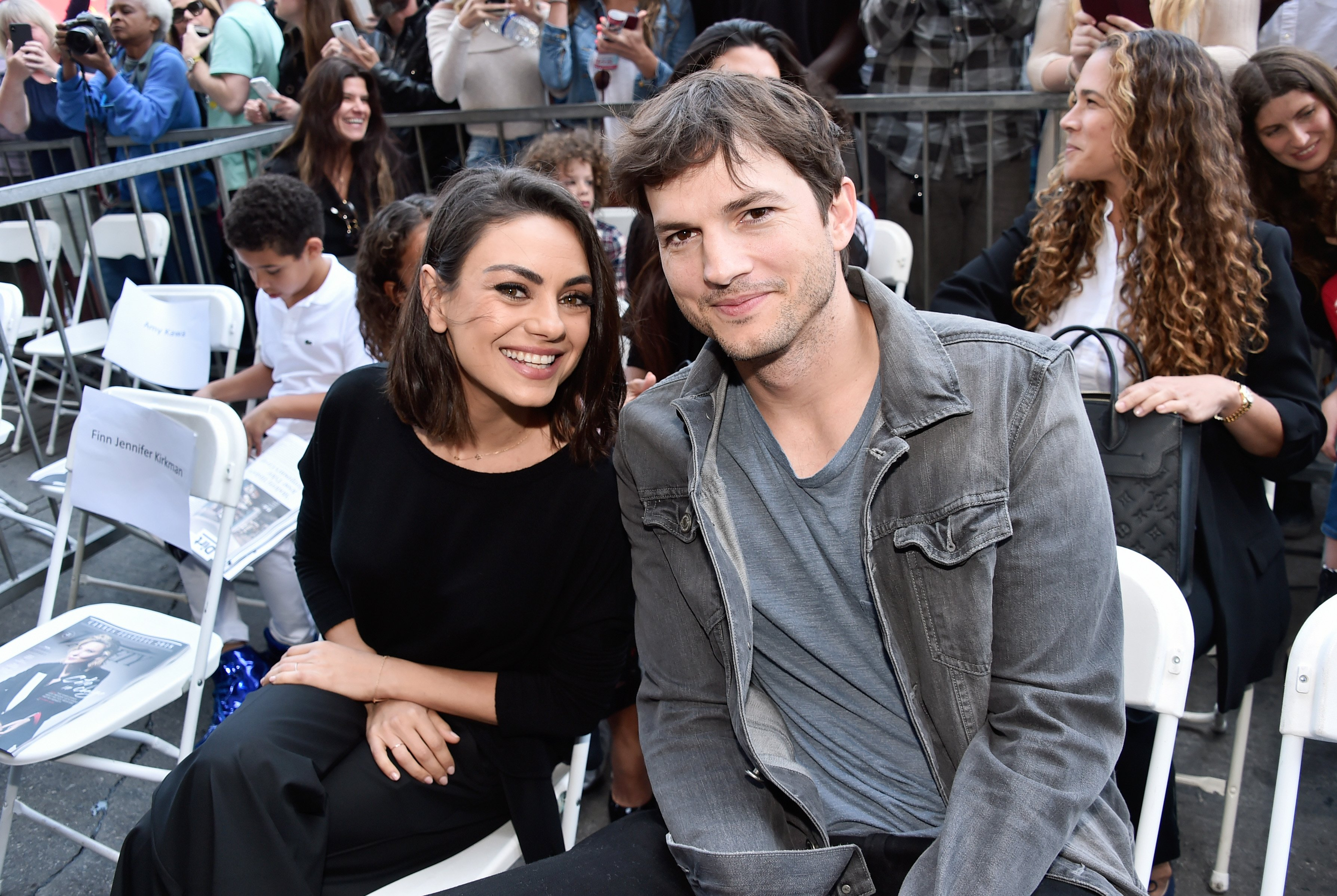 Image Credits: Getty Images / Alberto E. Rodriguez | Actors Mila Kunis (L) and Ashton Kutcher at the Zoe Saldana Walk Of Fame Star Ceremony on May 3, 2018 in Hollywood, California.
