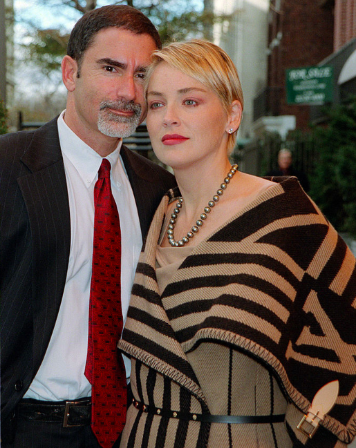 Image Credits: Getty Images / Sharon Stone and her husband Phil Bronstein stand outside their hotel