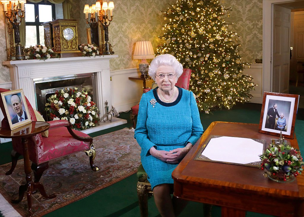 mage Credit: Getty Images / Queen Elizabeth II sits at a desk in the Regency Room after recording her Christmas Day broadcast on December 24, 2016 in London, England.