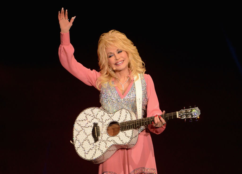 Image Credits: Getty Images / Richard Martin-Roberts / Redferns | Dolly Parton performs on stage at the Echo Arena on June 8, 2014 in Liverpool, United Kingdom.