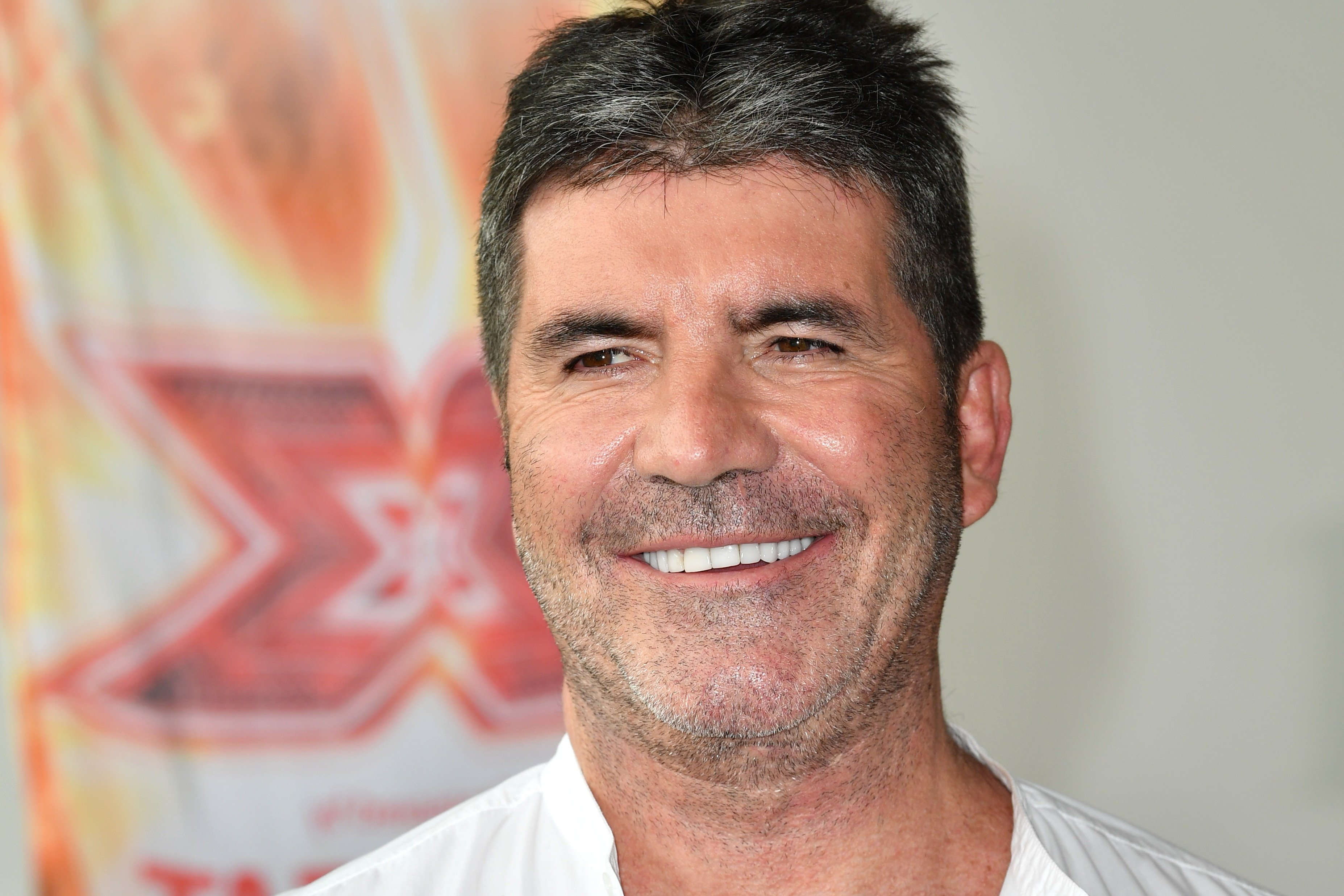Simon Cowell Image Source: Getty Images.